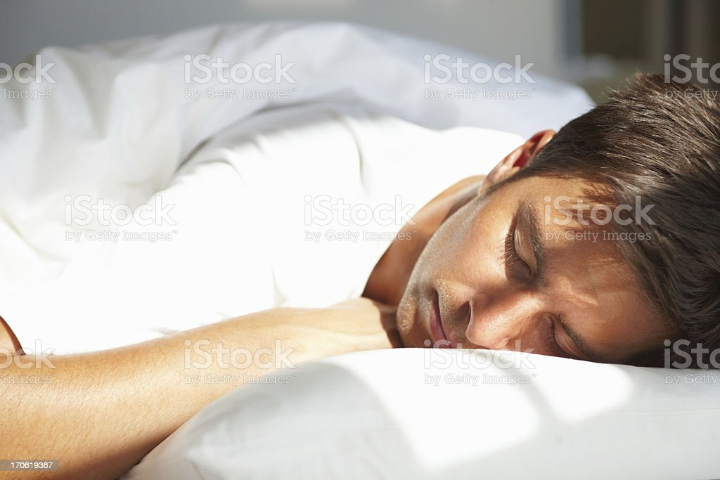 Young man relaxing with eyes closed stock photo