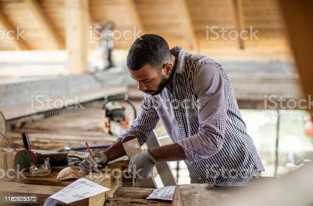 Young Man Renovating The Attic Stock Photo - Download Image Now