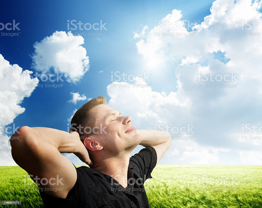 young man rest on wheat field royalty-free stock photo