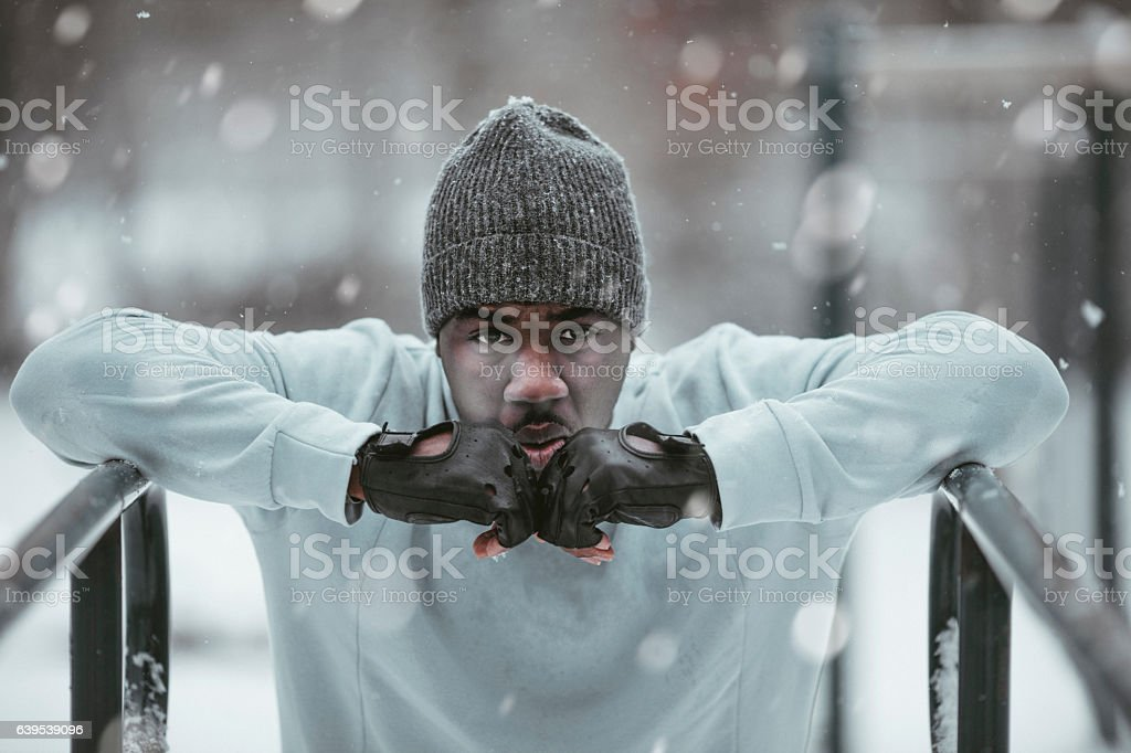 Young man resting after a workout stock photo