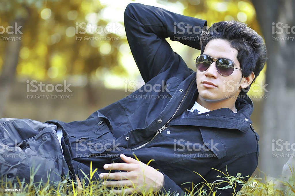 Young man resting on grass royalty-free stock photo