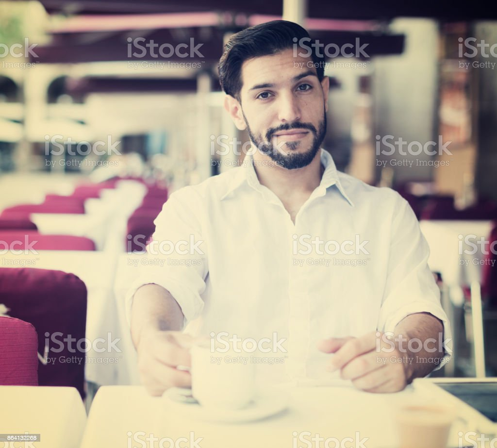Young man resting on summer terrace cafe royalty-free stock photo