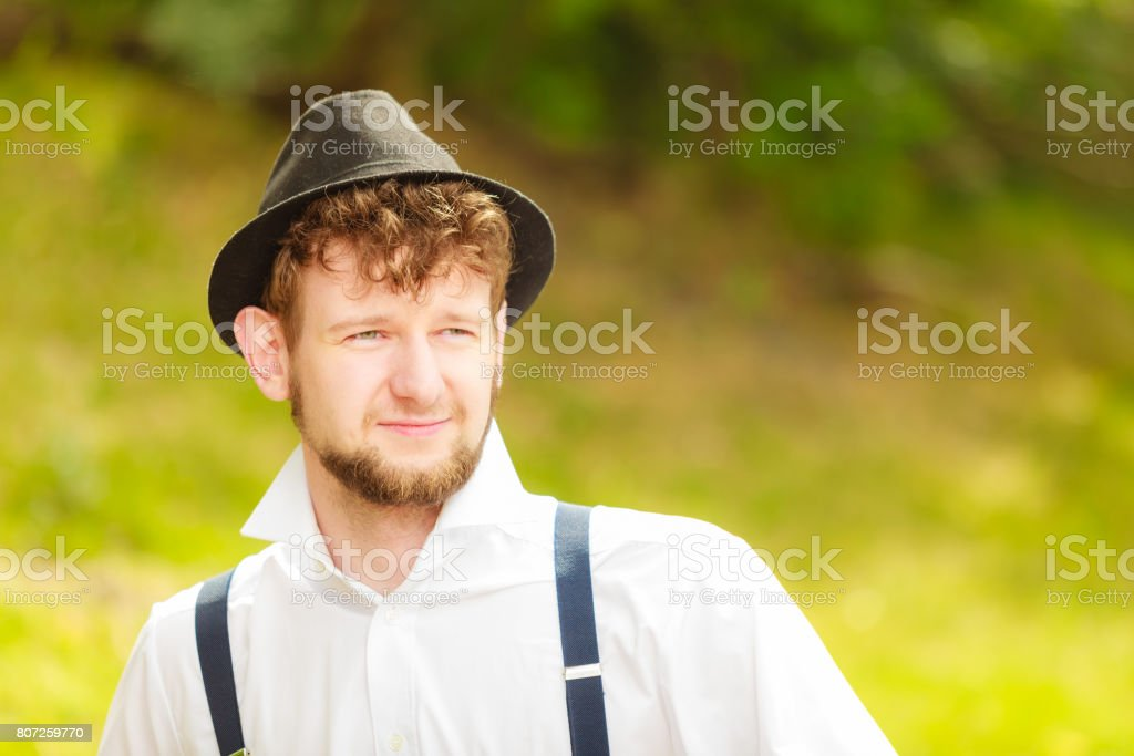 young man retro style portrait outdoor stock photo