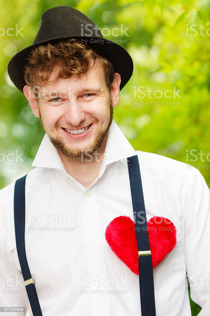 young man retro style with red heart on chest stock photo