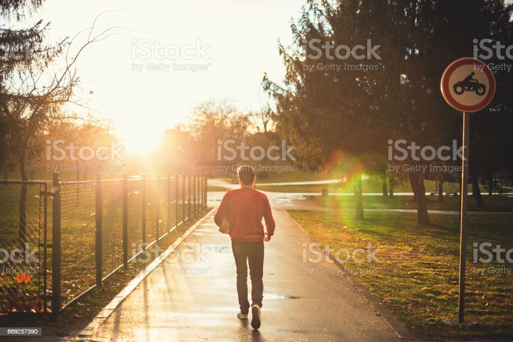 Young man returning home stock photo