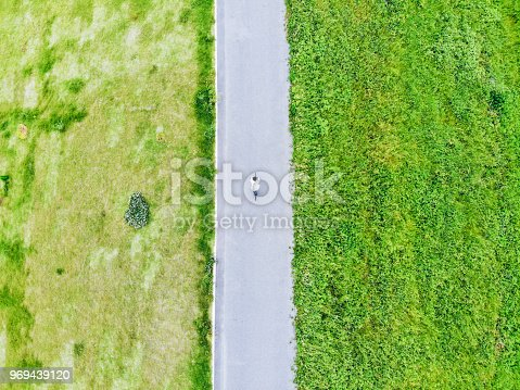 969439086 istock photo Young man riding a bicycle on a road 969439120