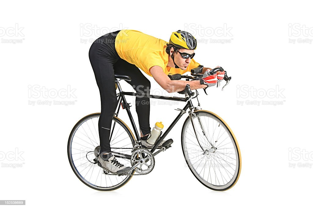 Young man riding a bicycle royalty-free stock photo