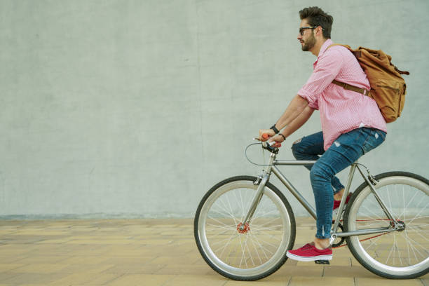Young man riding a bike in the city stock photo