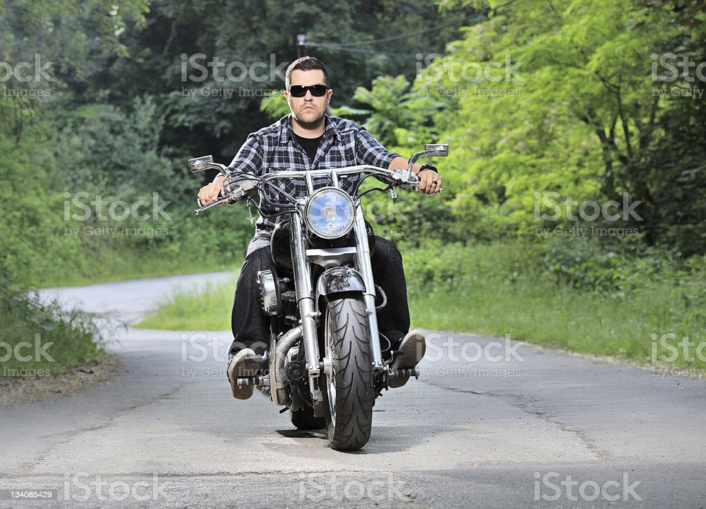 Young man riding a chopper stock photo