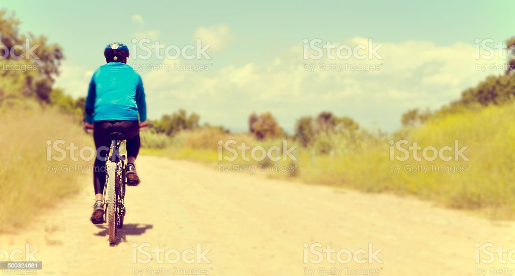 young man riding a mountain bike stock photo