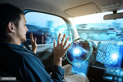 istock Young man riding autonomous car. 949302508