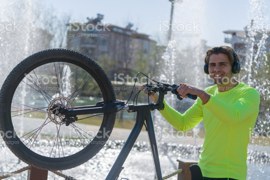 Young man riding bike in the park royalty-free stock photo