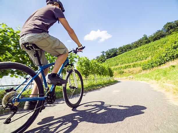 Young man riding his mountain bike stock photo