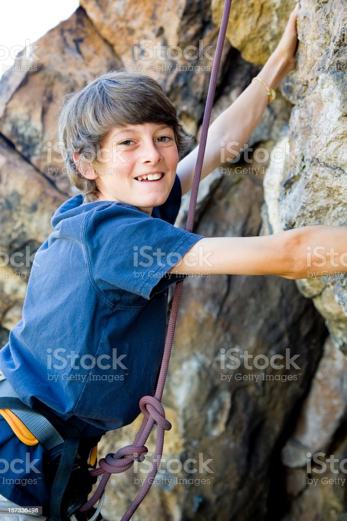 Young Man Rock Climbing royalty-free stock photo