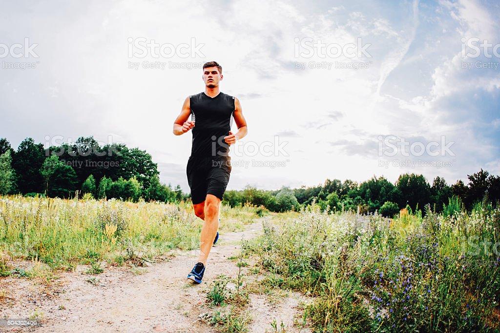 Young man running stock photo