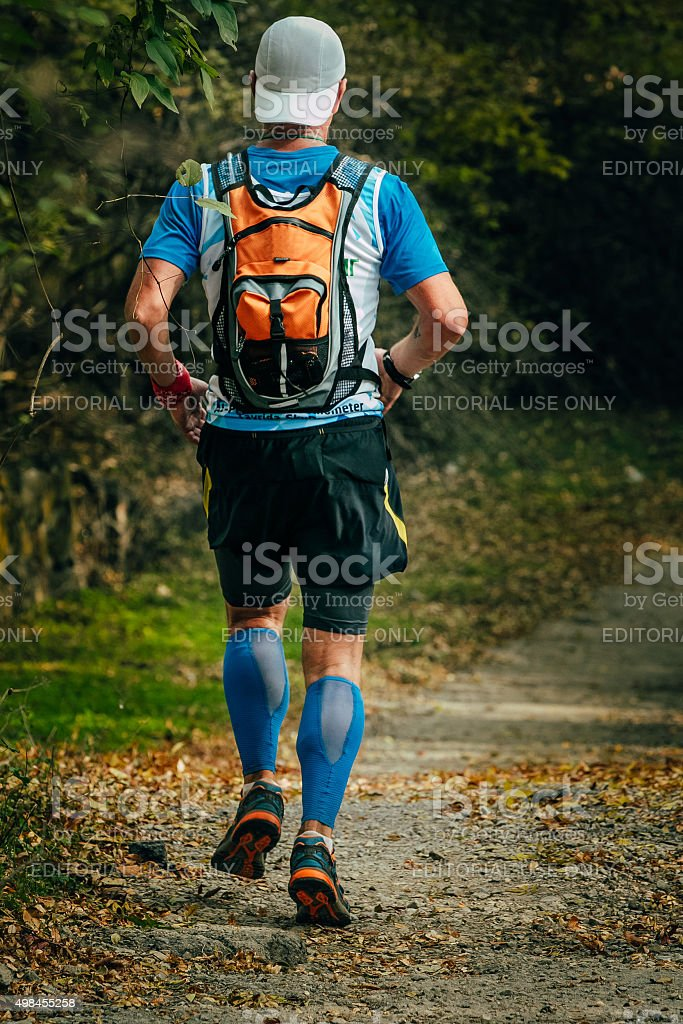 young man runs through Park stock photo