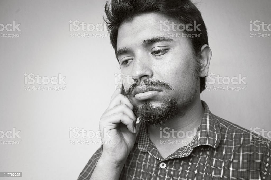 Young man, sad on the phone. royalty-free stock photo