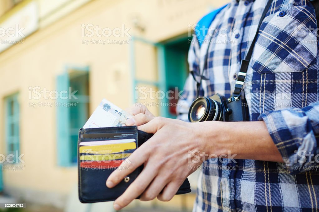 Young Man Saving Money for Traveling stock photo