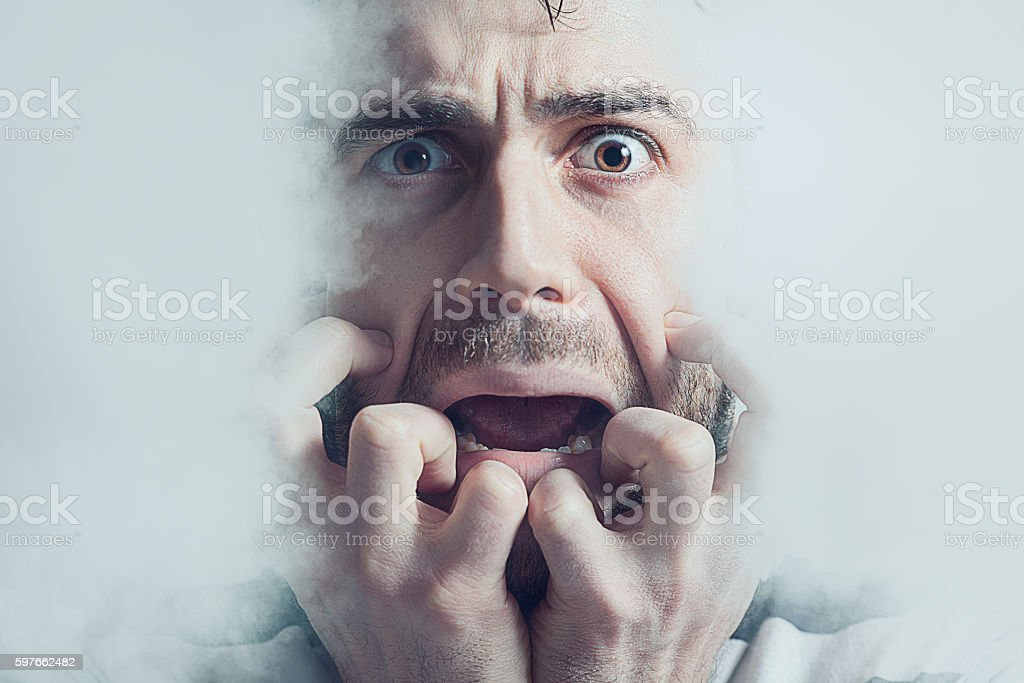 Young man screaming in despair. stock photo