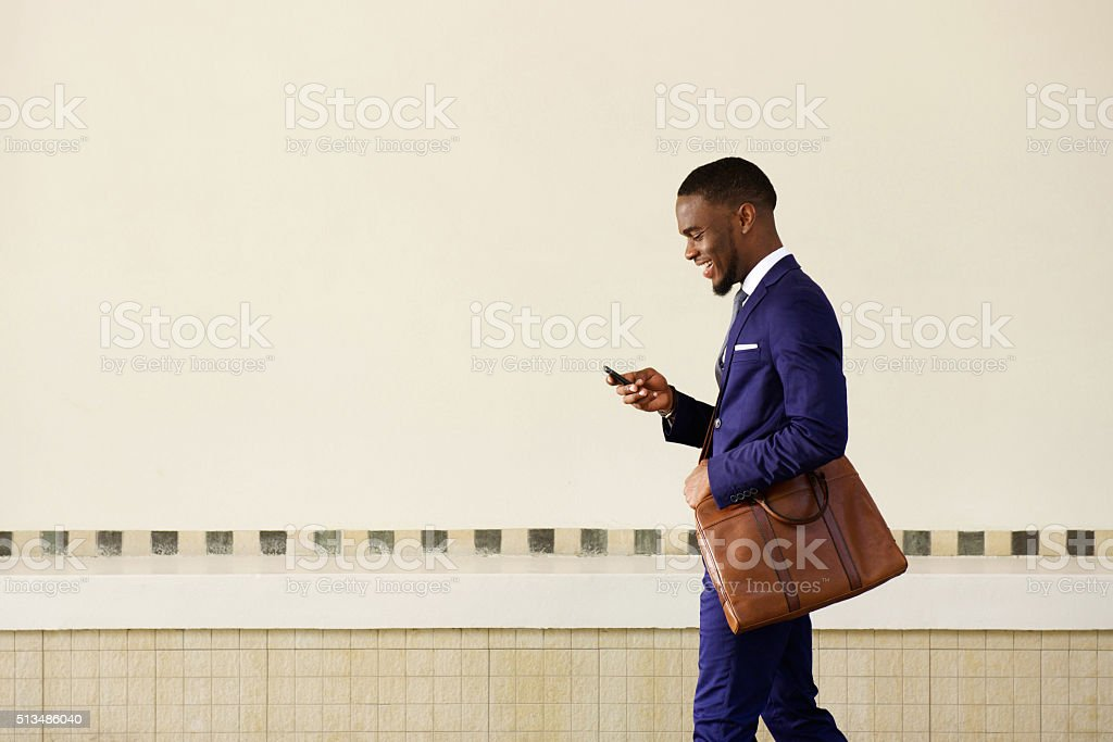 Young man sending text message on his mobile phone stock photo