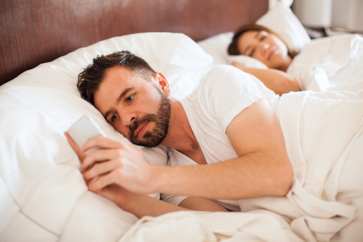 istock Young man sending texts to her lover 598919850
