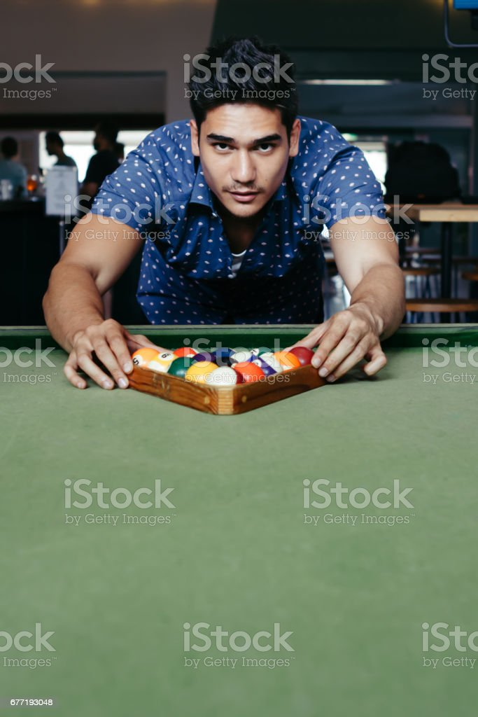 Young man setting up for a game of bialliards in an Australian pub stock photo