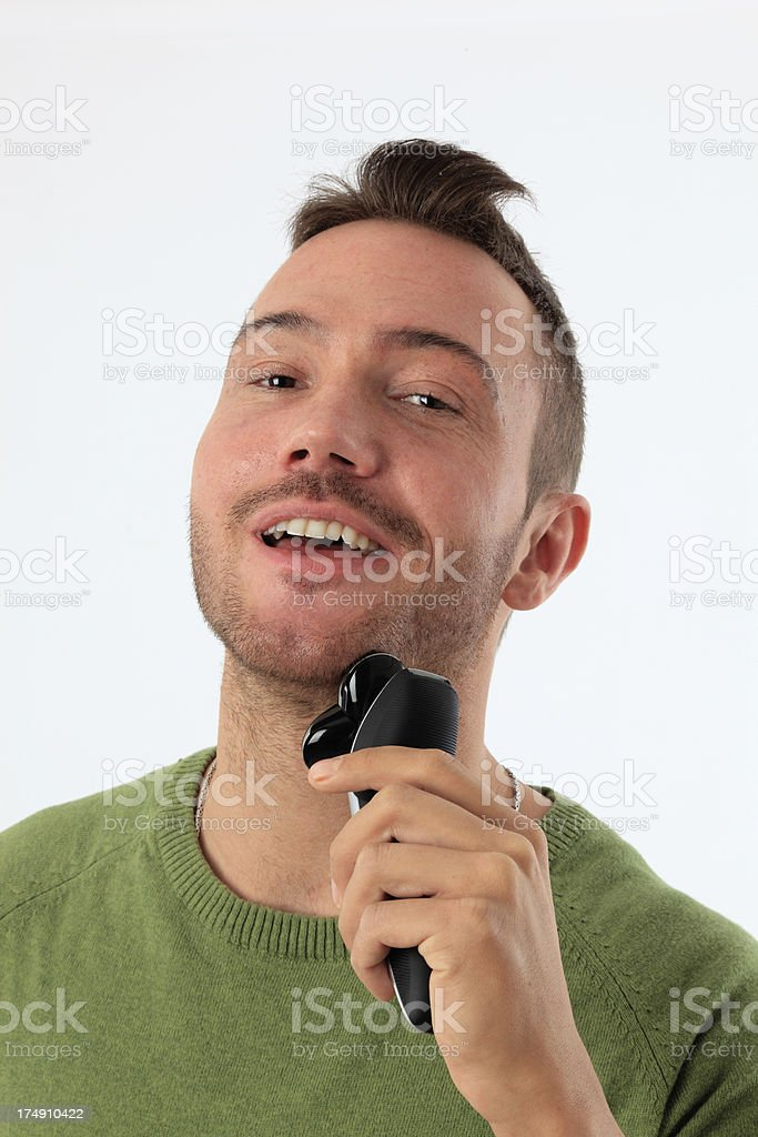 young man shaving royalty-free stock photo