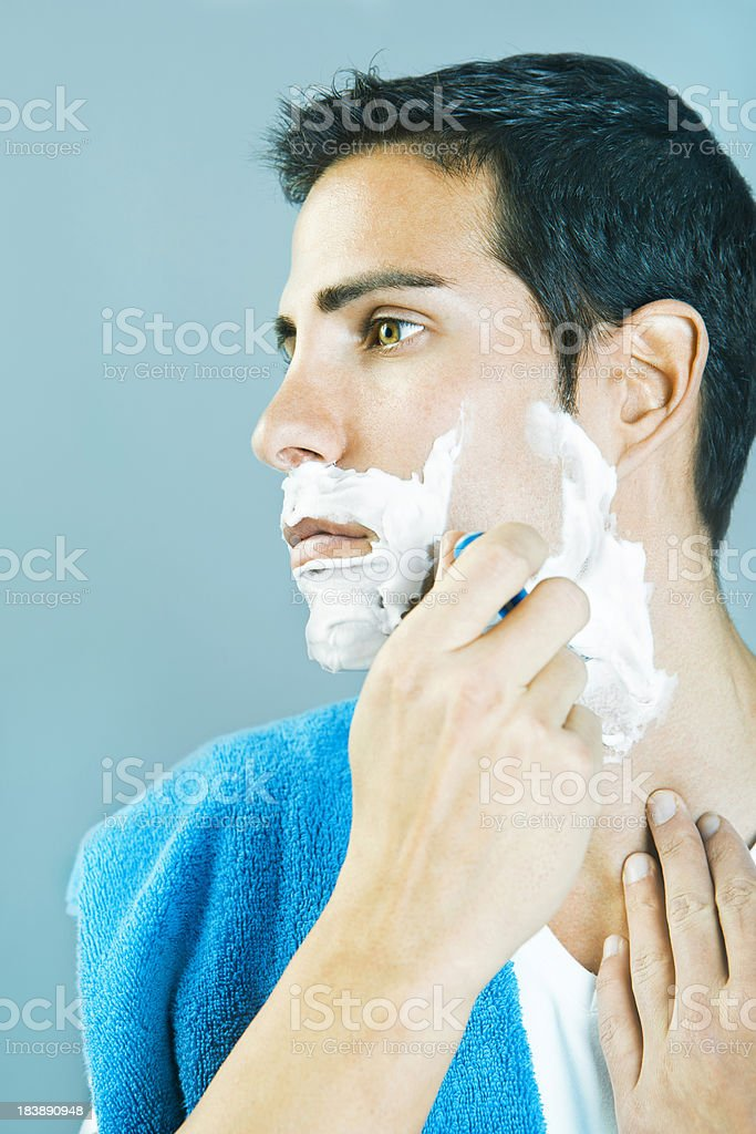Young man shaving royalty-free stock photo