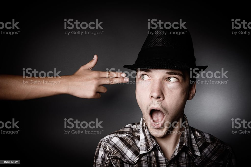 Young Man Shocked With Hand Gun Gesture At His Head royalty-free stock photo