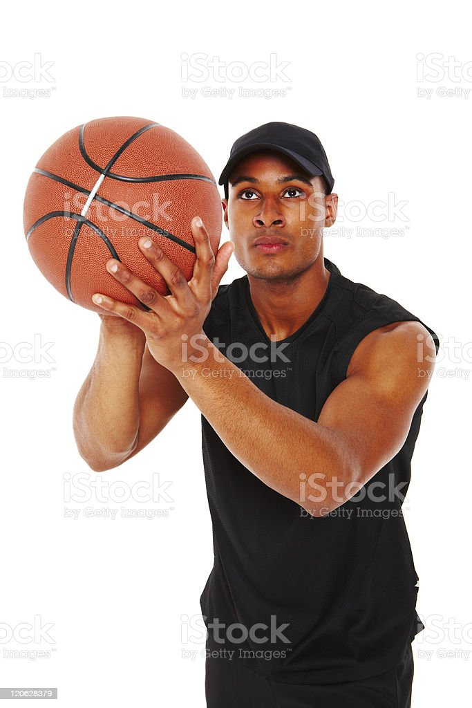 Young Man Shooting a Basket - Isolated stock photo