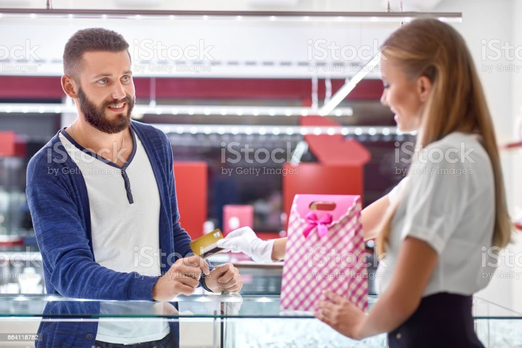Young man shopping at the jewelry store royalty-free stock photo