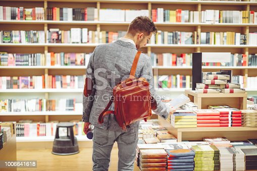 Young man shopping books