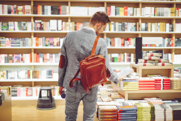 Young man shopping books stock photo