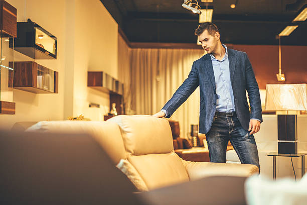 young man shopping furniture - furniture shopping stock photos and pictures