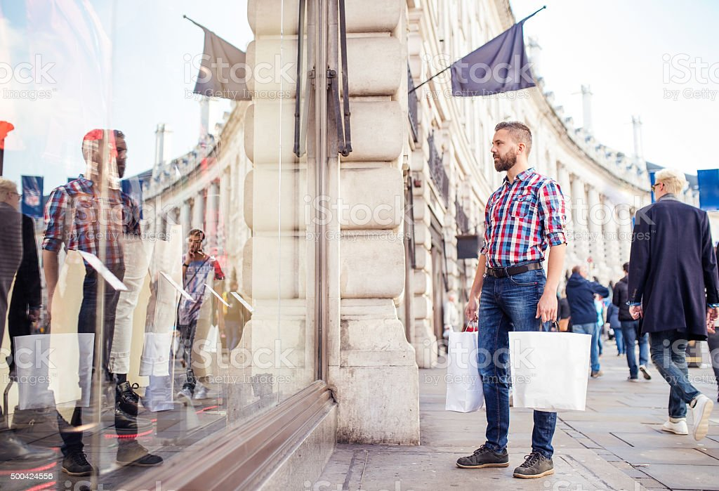 Young man shopping in the city royalty-free stock photo