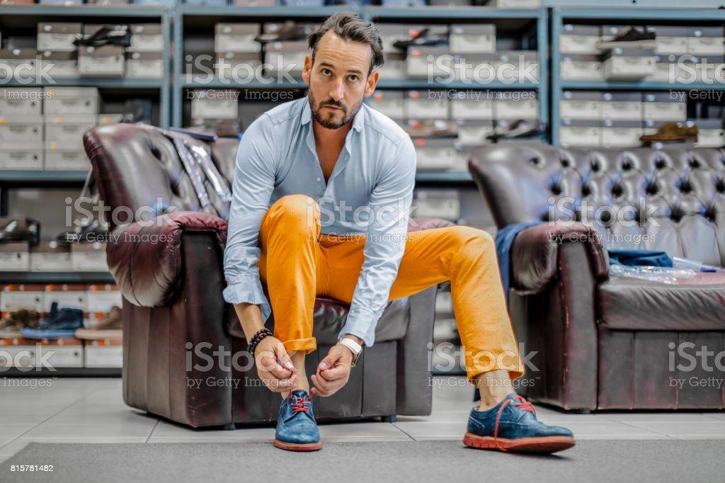 Young man shopping shoes