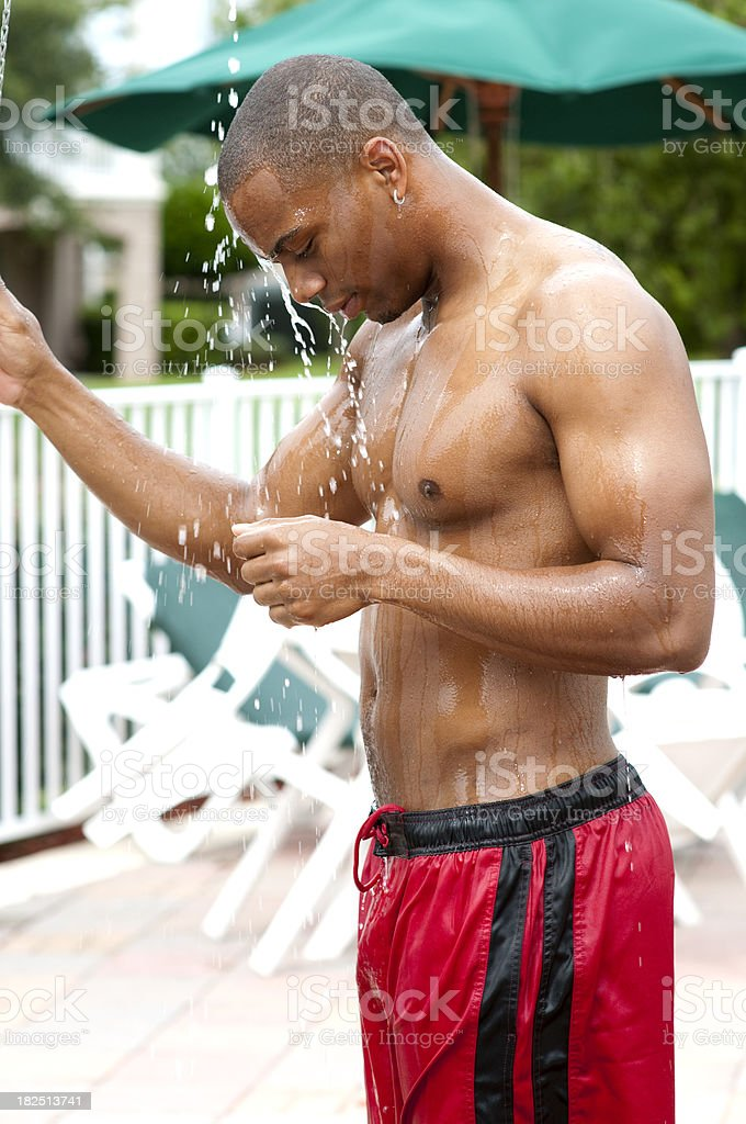 Young Man Showering by the Pool royalty-free stock photo