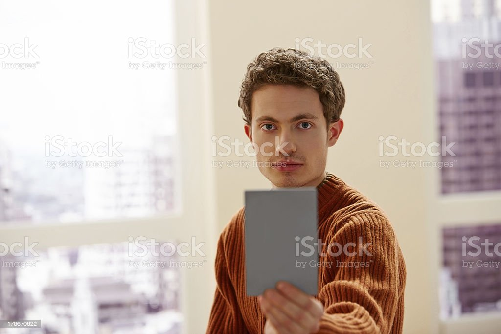 Young man showing a blank copy space to you royalty-free stock photo