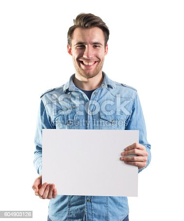 istock young man showing a blank paper page, clipping path included 604903126