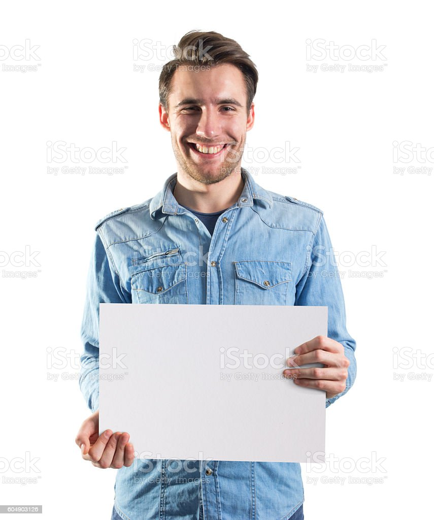 young man showing a blank paper page, clipping path included stock photo