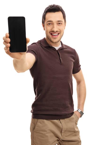 電話を見せる若者 - 見せる ストックフォトと画像