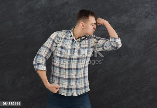 Young Man Showing And Kissing His Biceps Stock Photo & More Pictures of Adult