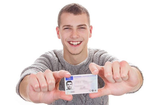 young man showing his driver license - cursed stock pictures, royalty-free photos & images
