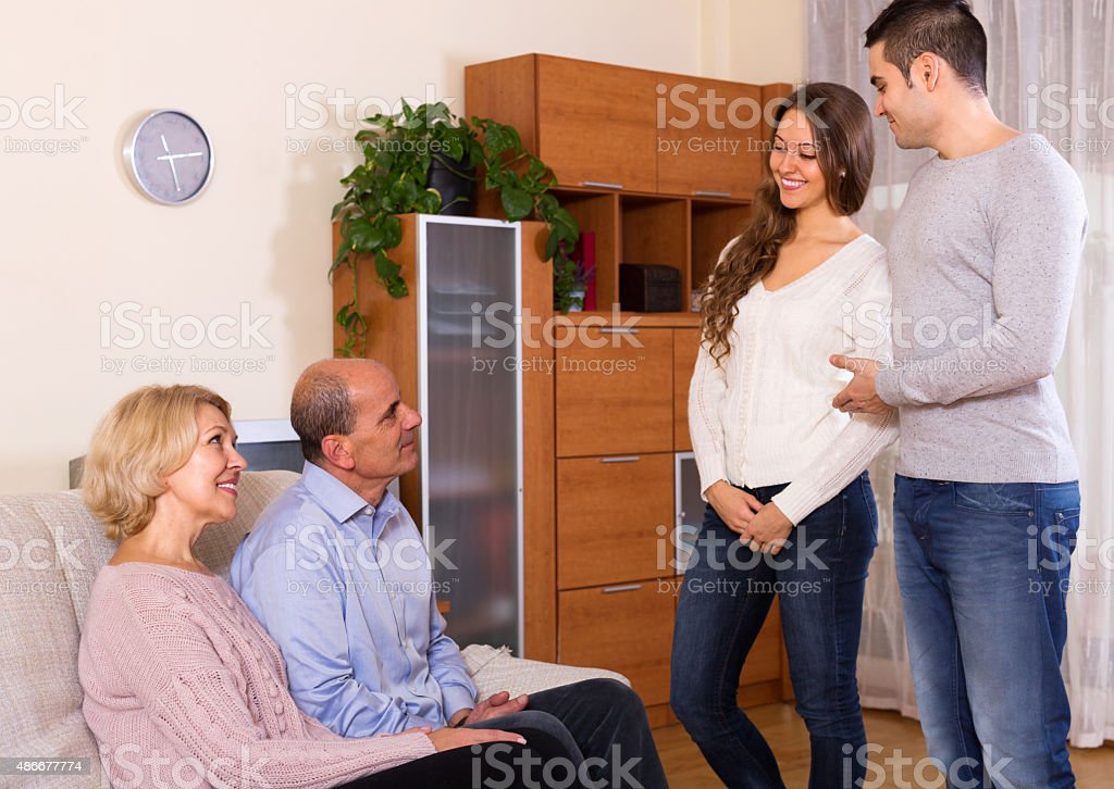 young man showing his future wife stock photo