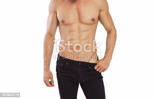 Young man showing his  muscle against white background studio shot