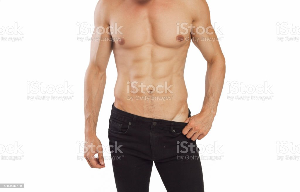 Young man showing his  muscle against black background stock photo