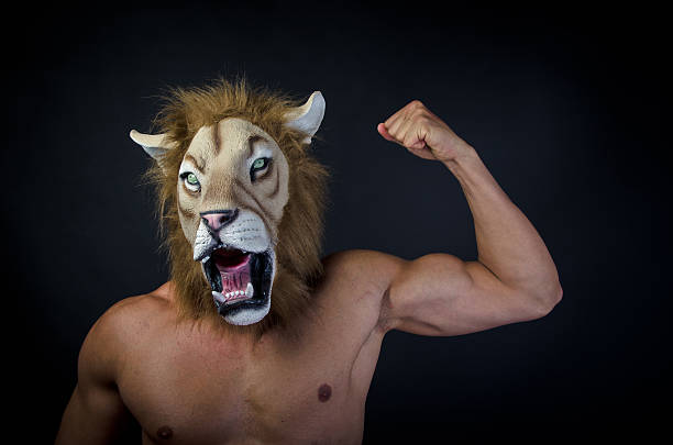 Royalty Free Mask Lion Muscular Build Men Pictures, Images ...