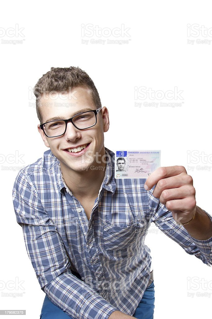 Young man showing off his driver license stock photo