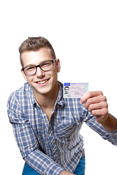 young man showing off his driver license - cursed stock pictures, royalty-free photos & images