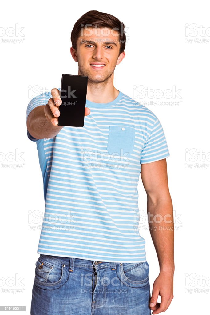 Young man showing phone to camera stock photo
